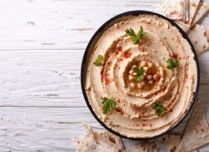 Sprouted hummus being served